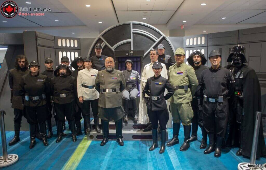 Photograph of Kim's Convenience start Paul Sun-Hyung Lee and members of the 501st Legion in full Star Wars costumes.